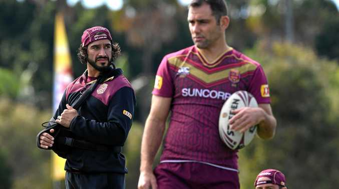 INJURED STAR: Johnathan Thurston (left) looks on during the Queensland State of Origin team training session at Sanctuary Cove on the Gold Coast.