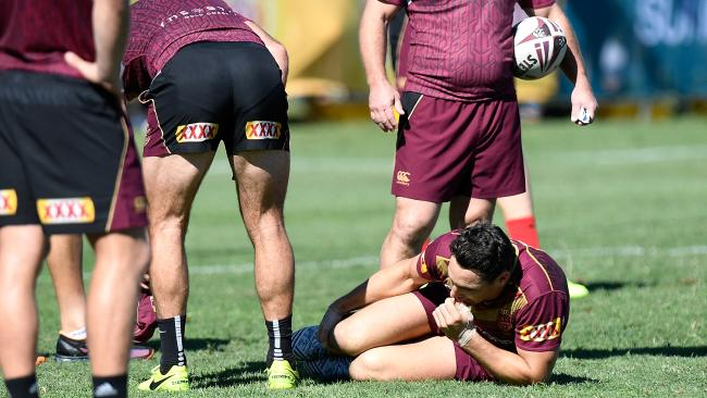 Billy Slater goes down injured during a Queensland Maroons State of Origin training session at Sanctuary Cove.