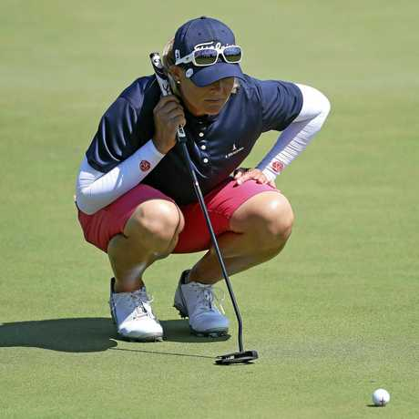 Katherine Kirk lines up a putt during the second round of the Thornberry Creek LPGA Classic golf tournament.