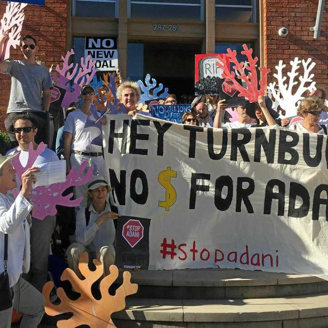 Protesters against the Adani coal mine make their feelings known outside Prime Minister Malcolm Turnbull's electorate office in Sydney on May 25.