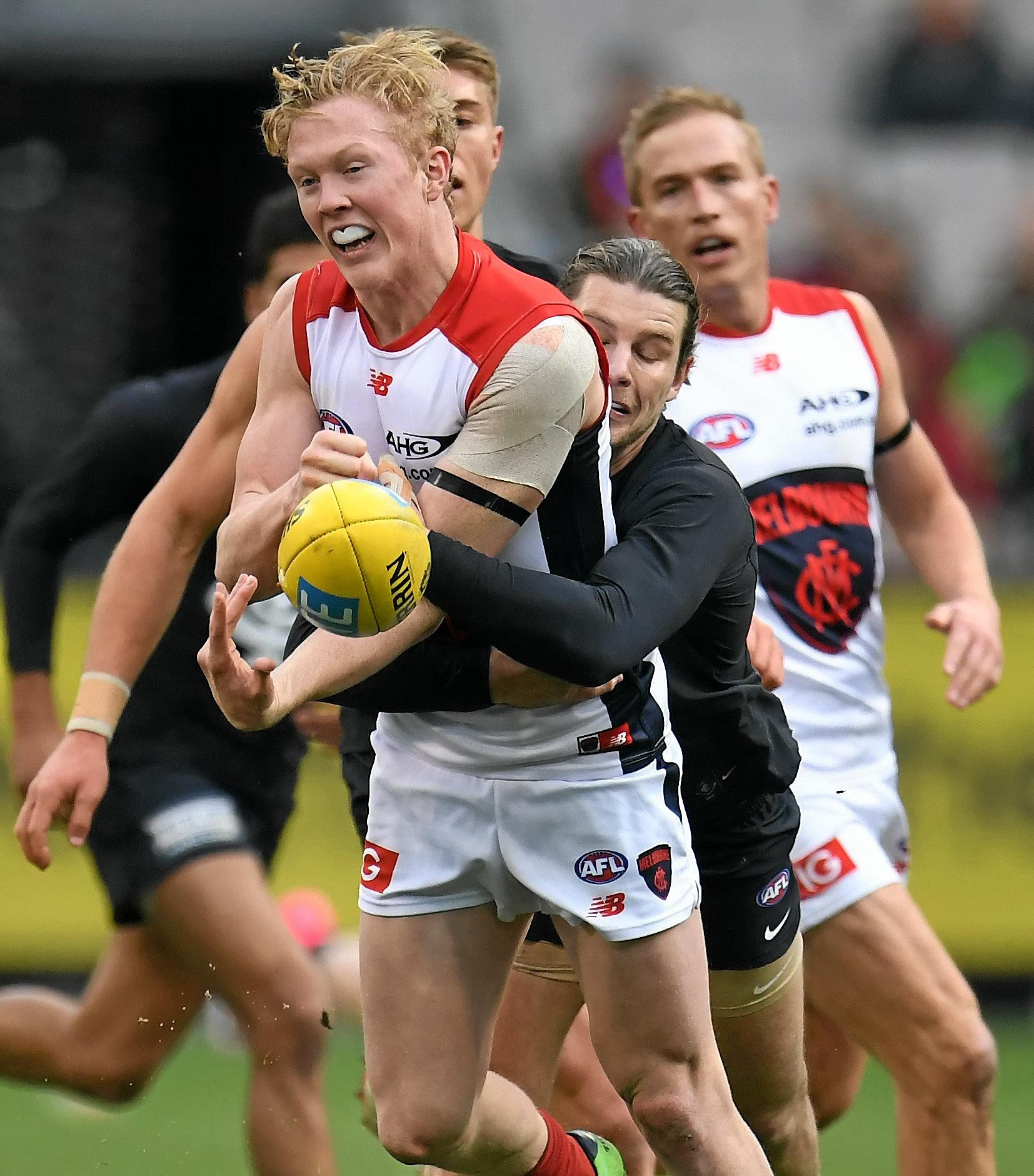 CLUB PROBE: Clayton Oliver (with the ball) is the subject of an inquiry by his Melbourne club into an alleged clash with a fan.