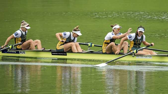 CELEBRATION TIME: The Australian women's four crew (from left) Lucy Stephan, Katrina Werry, Sarah Hawe and Molly Goodman after their World Cup final win in Lucerne, Switzerland