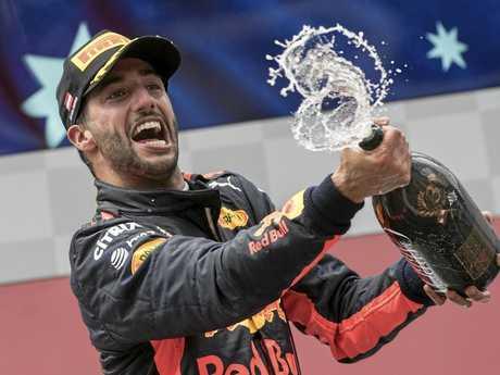 Third placed Australian Formula One driver Daniel Ricciardo of Red Bull Racing celebrates on the podium after the 2017 Formula One Grand Prix of Austria.