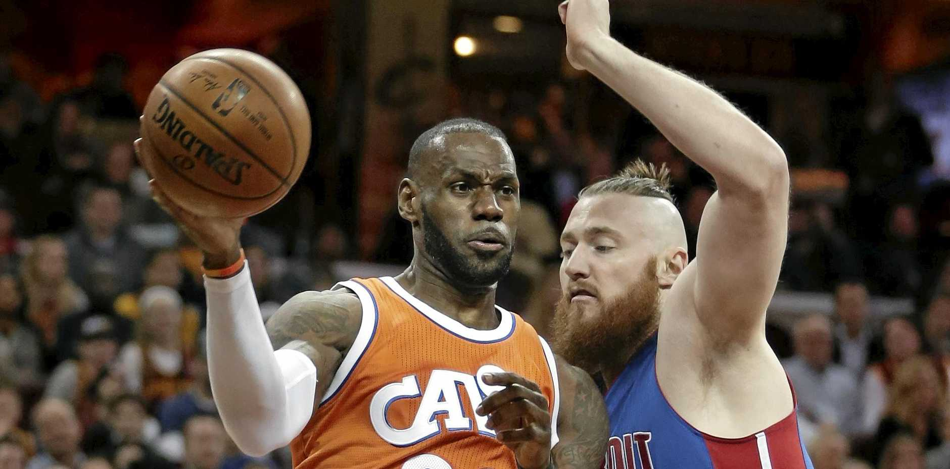 NBA ACTION: Cleveland Cavaliers' LeBron James drives against Detroit Pistons' Australian centre Aron Baynes.