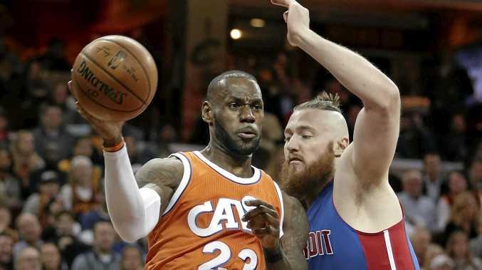 NBA ACTION: Cleveland Cavaliers' LeBron James drives against Detroit Pistons' Australian centre Aron Baynes.
