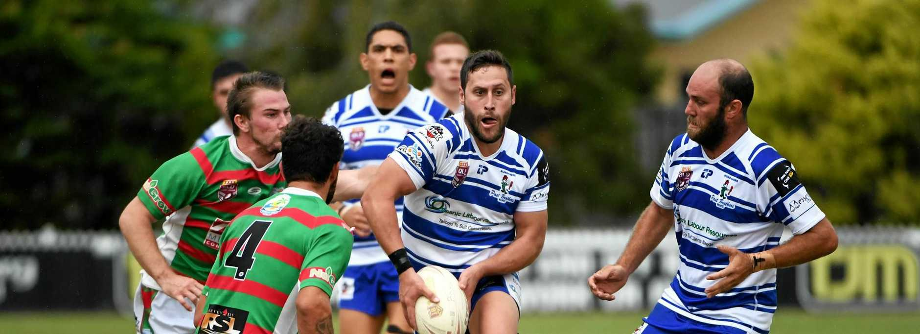 BIG WINNERS: Past Brothers' Mathew Ohlbrecht looks to offload the ball during the Toyota Cup final against Hervey Bay.