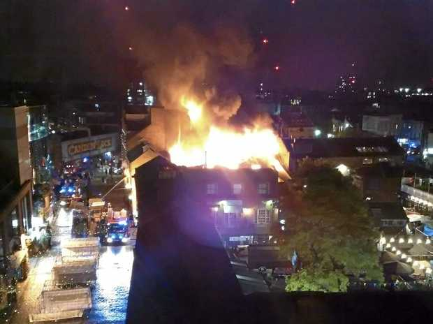 Flames and smoke rise from a fire affecting a small area of Camden Market.