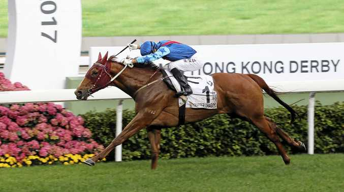 WINNING RIDE: John Moore-trained Rapper Dragon (No. 1), ridden by Joao Moreira, edges Pakistan Star (No. 3) to win the BMW Hong Kong Derby at Sha Tin Racecourse.