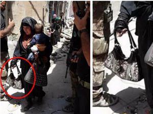Woman cradles baby before detonating bomb