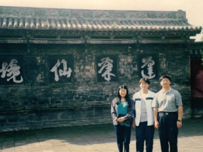 Barry pictured with his father Yanjiang Li and mother Xiaoyu Gao in 1999 in Beijing's Summer Palace.