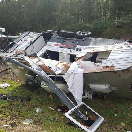 A truck and caravan rollover has shut down part of the Bruce Highway on the Sunshine Coast.