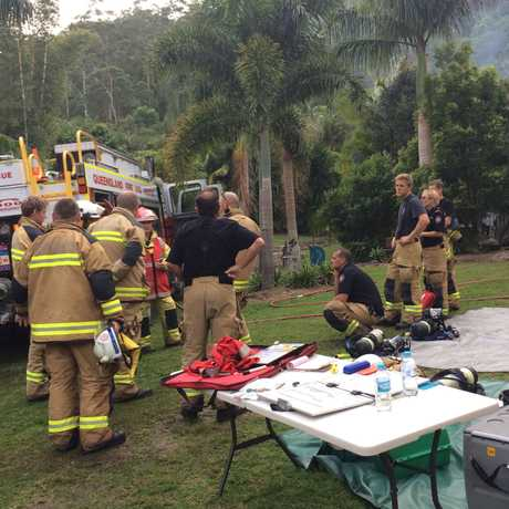 Firefighters debrief after extinguishing a shed fire at a Maroochy River property.