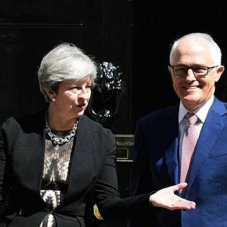 Malcolm Turnbull tours Borough Market, the site of a terror attack that cost two Australian lives, with British Prime Minister Theresa May.