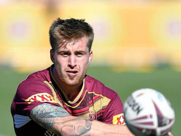 Cameron Munster passes the ball during a Maroons training session at Sanctuary Cove .