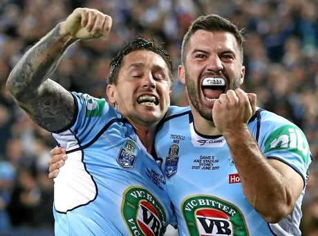 SYDNEY, AUSTRALIA - JUNE 21:  Mitchell Pearce and James Tedesco of the Blues celebrate after Pearce scored a try during game two of the State Of Origin series between the New South Wales Blues and the Queensland Maroons at ANZ Stadium on June 21, 2017 in Sydney, Australia.  (Photo by Ryan Pierse/Getty Images)