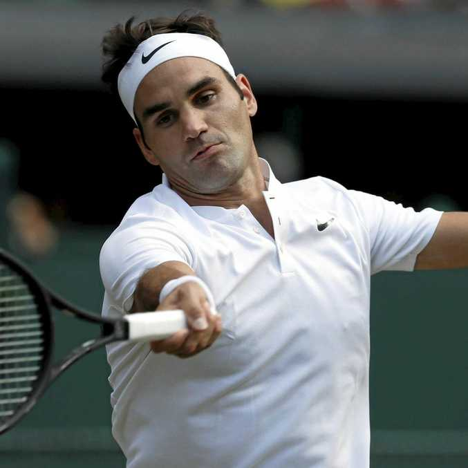 Switzerland's Roger Federer returns to Bulgaria's Grigor Dimitrov during their Men's Singles Match