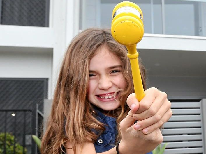 YOUNGEST AGENT: Eight year old Gabby Dobbin-Lavery helped seal the deal in her first ever property sale.