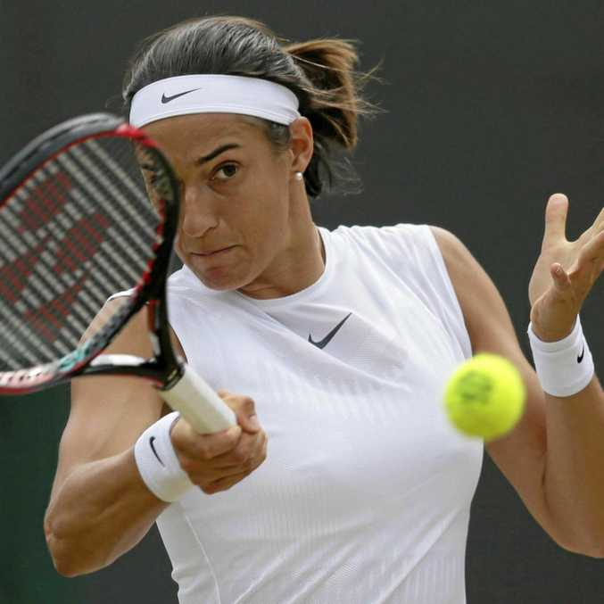 TACTICS QUESTIONED: The father of French player Caroline Garcia has been accussed of using illegal hand gestures to coach her during her loss to Britain's Johanna Konta at Wimbledon.