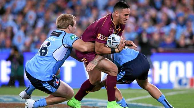 Valentine Holmes of the Maroons is tackled by Jake Trbojevic (left) and Nathan Peats of the Blues in Origin II.