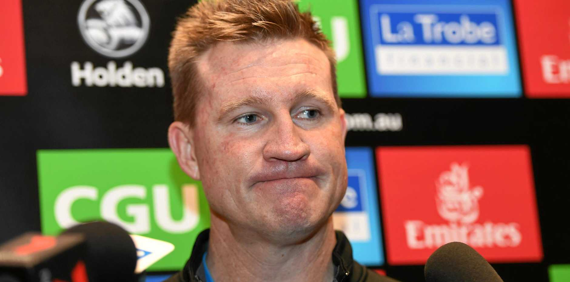 Magpies coach Nathan Buckley fronts the media.