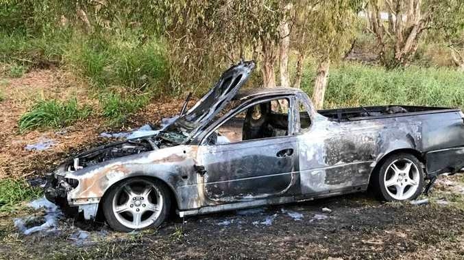 This black Holden Commodore ute was stolen from a Marian address and found torched