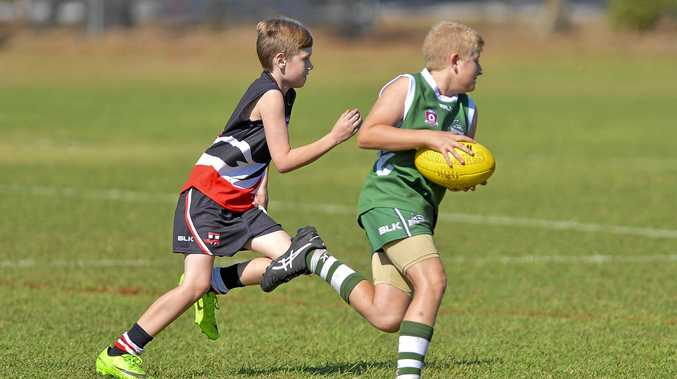 BITS player Kayden Toohey and Gladstone player Taj Hubner in action. Under 11 Junior Football between Gladstone and BITS.