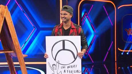 Toyota ambassador Guy Sebastian draws the brand logo