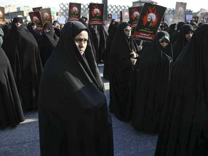 Women attend a rally in Tehran, Iran to protest Saudi Arabia's execution of Sheikh Nimr al-Nimr, a prominent opposition Shiite cleric, seen in posters. (AP Photo/Vahid Salemi) FILE