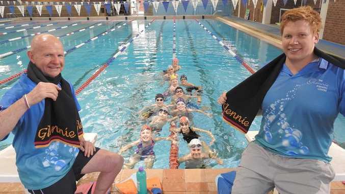 Jeffrey Davidson (Swim Coach) and Codie Grimsey (Glennie Head Swim Coach) warm up with squad swimmers.