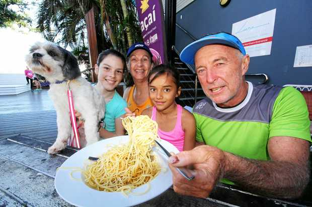 Whitsunday Running Club members Robyn Corrigan and Mark McConkey with Jazelle Fletcher, Jazmyn Fyvie and Pippy the dog promote the up-coming pasta party at Club Croc on July 14.