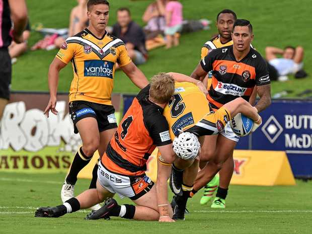 LEAGUE: The Sunshine Coast Falcons V Easts Tigers. Falcon's Matthew Soper-Lawler takes one up.