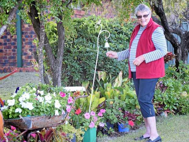 HOME, SWEET HOME: Jocelyn Robertson enjoying her garden at her Mundubbera home.