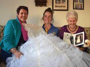 BEAUTY: Polly Leahy, Marnie Leahy and Marie Gore with the dress they all wore to their debutante balls.