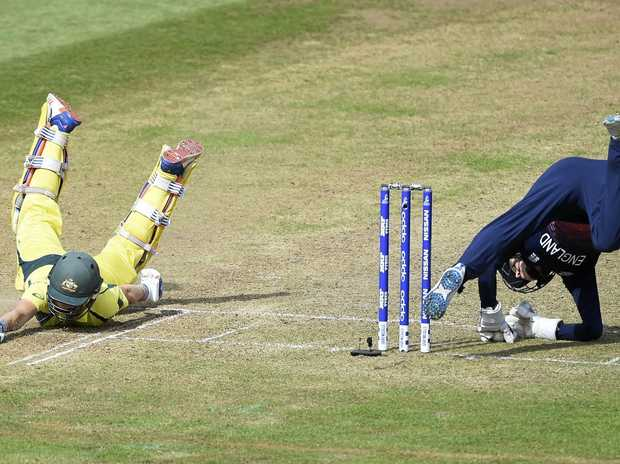 Australia's Ellyse Perry left dives to make her ground as England's Sarah Taylor takes a tumble during the Women's World Cup in England