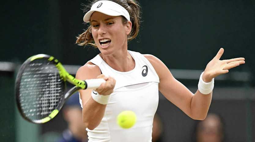 Australian-born Johanna Konta fires a forehand return during her quarter-final win over Simona Halep at Wimbledon.