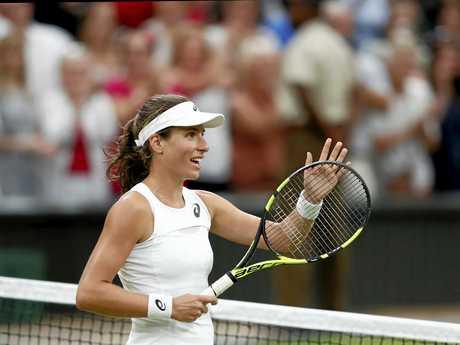 Johanna Konta of Britain moves through to the semi-finals at Wimbledon.