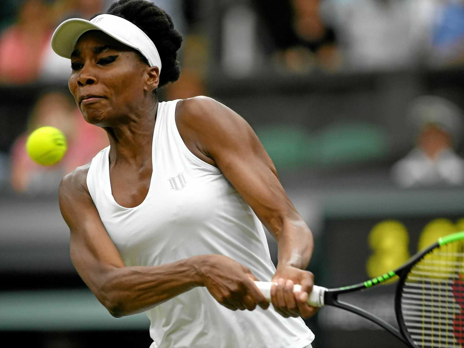 Venus Williams muscles up in her quarter-final clash againstJelena Ostapenko.