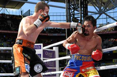 Jeff Horn hits Manny Pacquiao with a left during their world title fight earlier this month