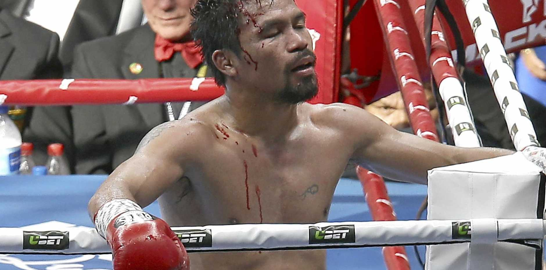 Manny Pacquiao reacts after going down to Jeff Horn in their WBO welterweight title fight.