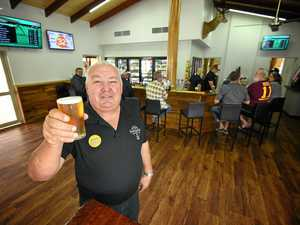 Doug raises glass to the 'soft opening' of his new pub