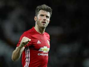 Carrick named to replace Rooney as skipper