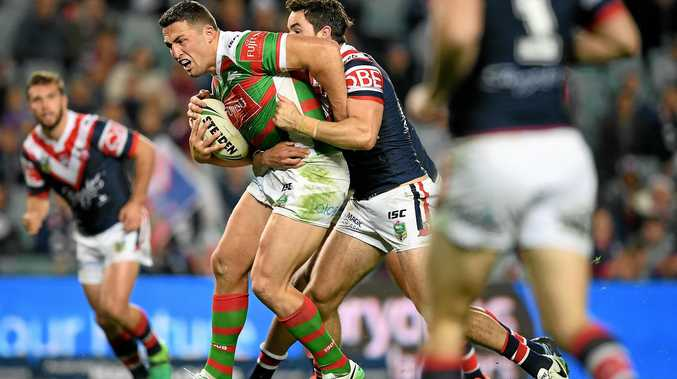 South Sydney skipper Sam Burgess is wrapped up by Roosters rival Aidan Guerra during their round 18 NRL match.