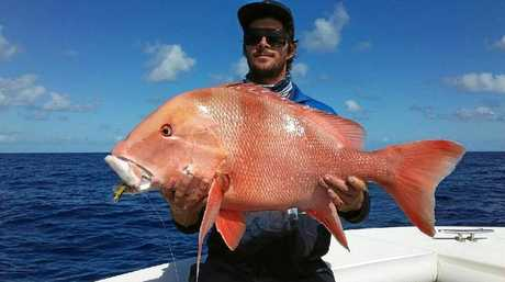 Jake Thompson with a red emperor caught at the reef.