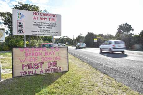 Signs placed at the southern and northern entrances to Byron Bay making it clear potholes should be fixed.