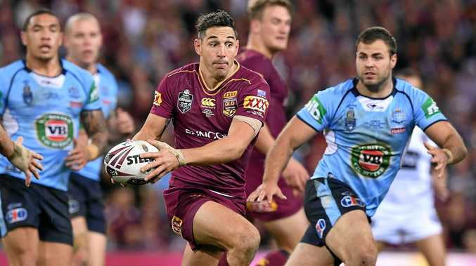 Billy Slater of the Maroons makes a bust.