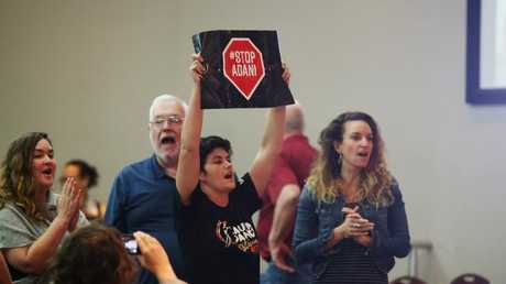 A group began catcalling and chanting during the meeting. Picture: Brendan Radke