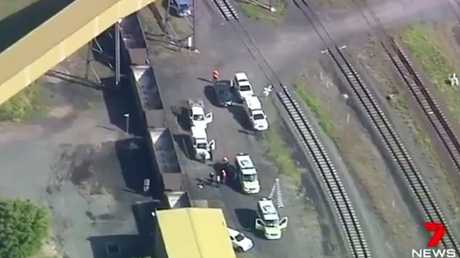 Police at the Port of Brisbane after a man's body was found in a coal wagon. Picture: 7 News Queenslan