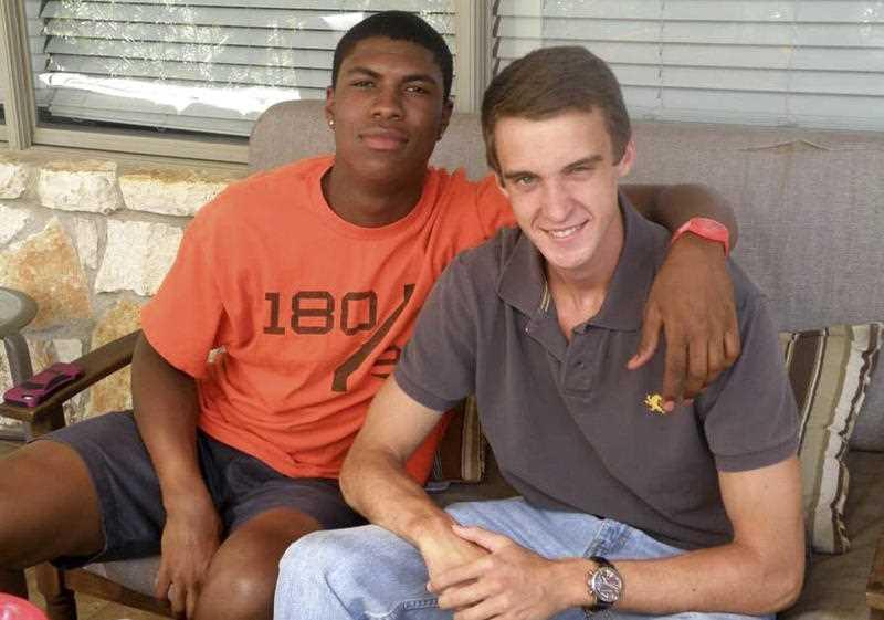 Bakari Henderson, left, with friend Travis Jenkins