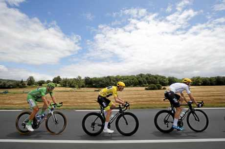 Germany's Marcel Kittel, wearing the green jersey, Britain's Chris Froome, wearing the overall leader's yellow jersey, and Germany's Christian Knees ride in the pack during the 11th stage of the Tour de France.