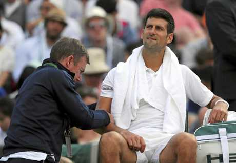 Serbia's Novak Djokovic receives medical treatment
